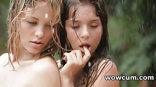 Outdoor lesbian action with two wet teens