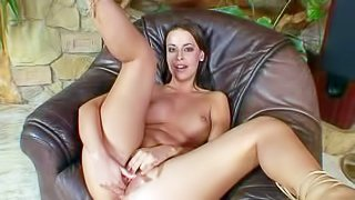 Attractive brunette cutie Stella with nice hooters and delicious ass spreads long legs and stuffs her sweet hairless honey pot with funky glass dildo in leather arm chair in solo action