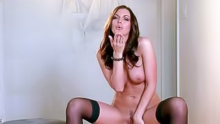 Paxton Lane is a nice dark haired babe with sexy legs, natural tits and beautifully trimmed pussy. Lovely babe in black nylon stockings gives a close-up view of her snatch. Enjoy!