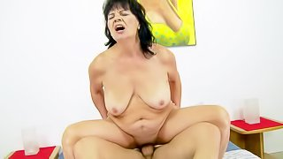 Helena May is a hot blooded mature brunette with loose pussy. She enjoys unforgettable sex with hard dicked young guy. Her fucks her vagina as deep as possible with his rock hard young dick