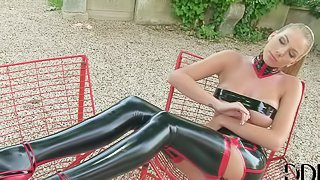 Danielle Maye is a latex clad sexy blonde. She shows off her perfect long legs and flashes her pussy in the backyard. Shes damn sexy in black latex stockings and high heels