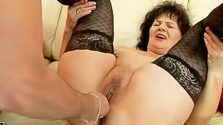 Nasty granny Helena May in black stockings gets her pussy and asshole toy fucked by her curious fuck buddy before he inserts his hard dick in her vagina. Watch older woman get pleasure